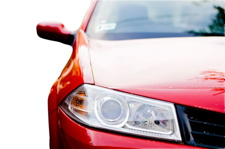 照らす: 赤い車のフロント ライト