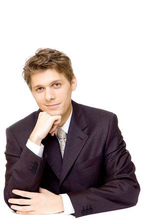 Handsome young businessman sitting at a table Stock Photo