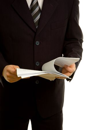 Businessman reviewing documents Stock Photo