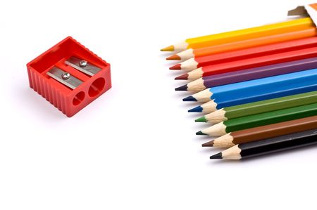 Colorful pencils with pencil sharpener