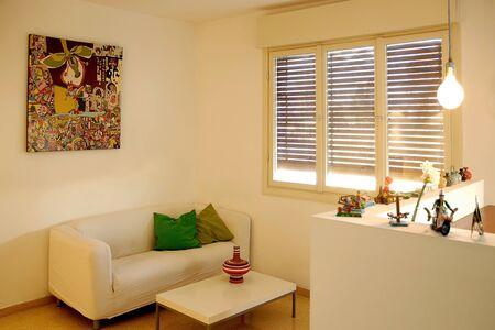 Modern living room with comfortbale white sofas