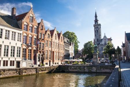 historical reflections: Statue of medieval painter Jan van Eyck in Bruges, Belgium