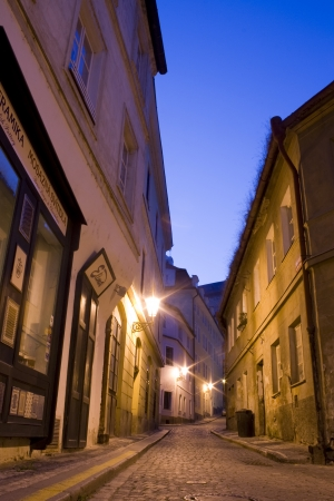 mysterious narrow alley with lanterns in Prague at night photo