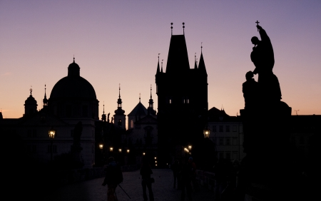 Prague tower from Charles bridge silhouette photo