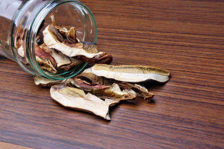 Muschrooms dried boletus edulis in a jar on the table photo