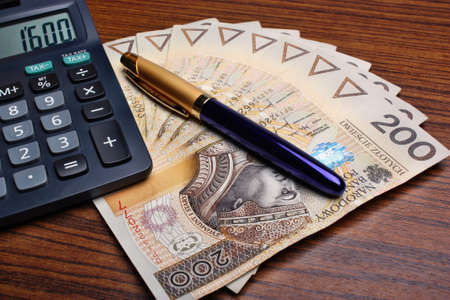 Money calculator pen on the table