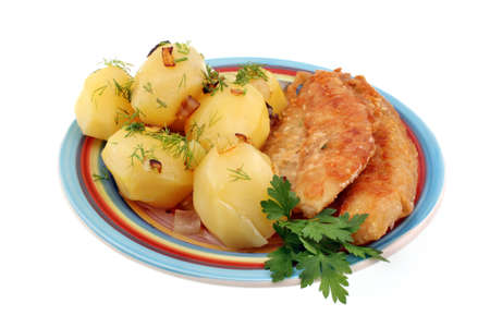Traditional dinner potatoes with fish topped with bacon fat and onions on a white background photo