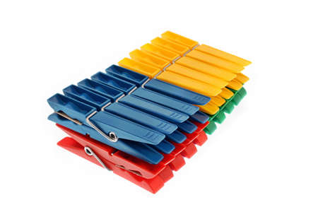 Colorful clothes pegs isolated photo