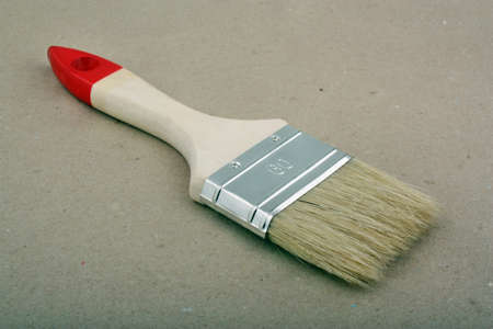 Brush for painting on a paper background photo