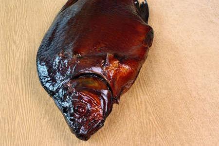 abramis: Fresh smoked fish head bream Stock Photo