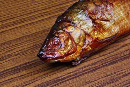 Fresh smoked fish head photo