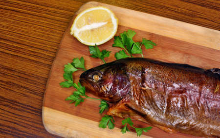 Fish smoked trout on a chopping board photo