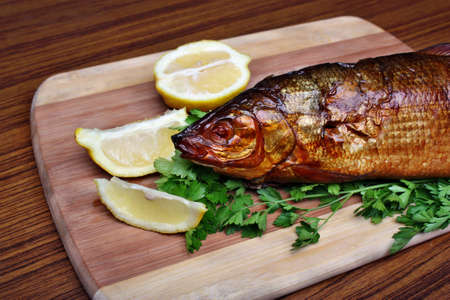 Fish smoked whitefish on a chopping board  photo