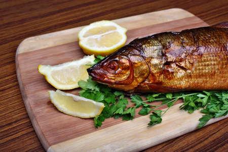whitefish: Fish smoked whitefish on a chopping board  Stock Photo