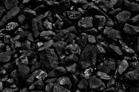 COAL MINER: Coal mine deposit mineral black cube stone background Stock Photo