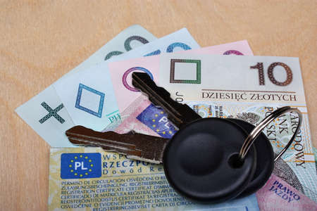 formalities: Documents car keys and money on the table Stock Photo