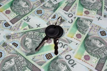 formalities: Car keys and polish money  background Stock Photo