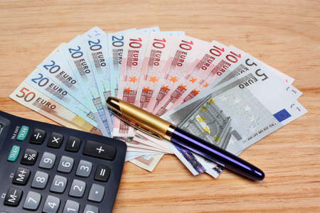Euro money calculator pen on the table Stock Photo