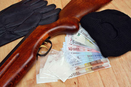 Things bandit criminal drug dealer gun, balaclava, gloves euro money on the table photo