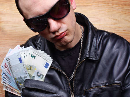 Chief boss mafia gangster thug with stolen money euro Stock Photo - 26051213
