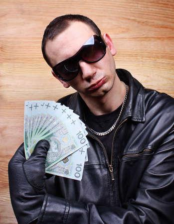 Mafia gangster with a fan polish money Stock Photo - 26051216