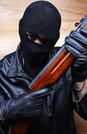 Gangster terrorist boss mafia criminal with a gun Stock Photo - 26051217