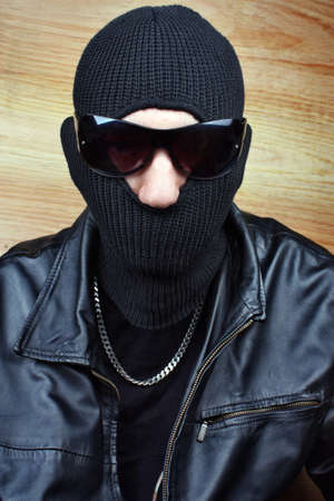 Dangerous gangster in balaclava bandit photo
