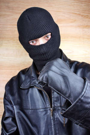 Evil criminal men in a black mask Stock Photo - 26406934