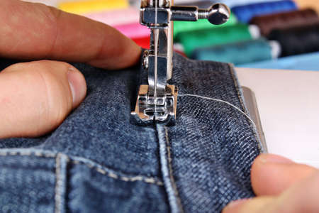 stitchwork: Sewing machine and item of clothing trousers jeans material