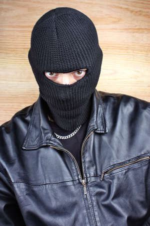 Masked thief in balaclava bandit gangster photo
