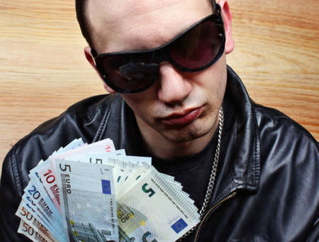 Chief boss mafia gangster thug with stolen money euro photo