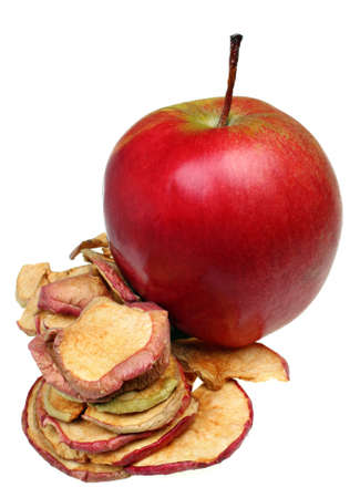 Raw apple slices and dried apples isolated