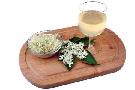 Health drink  from elderberry flowers on a white background photo