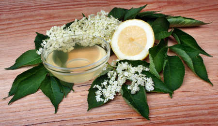 Health juicy  from elderberry flowers  on a wooden table photo