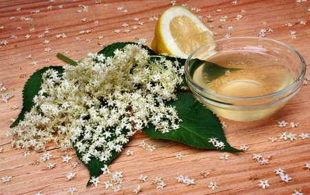 Health drink  lemonade from elderberry flowers  on a wooden table photo