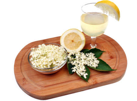 Health drink made from elderberry flowers on a white background photo