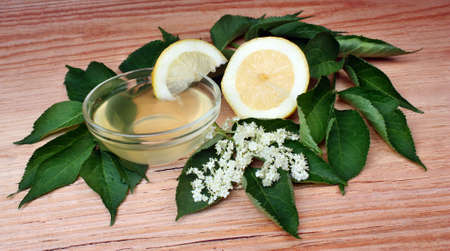 Health syrup  from elderberry flowers  on a wooden table photo