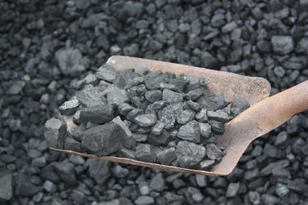 Shovel and coal in the background coal mine