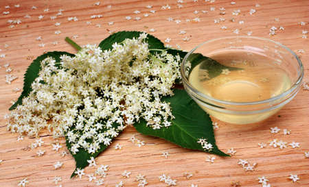 Health  elderberry flowers  on a wooden table photo