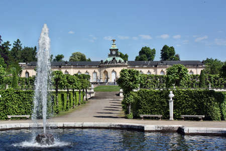 frederick street: Potsdam, Germany - May 19, 2013: The fountain in the background of the palace Bildergalerie. Sanssouci is the most famous palace of Frederick the Great