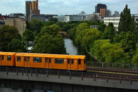 u bahn: Berlin, Germany - May 30, 2013: Subway U-bahn train crossing bridge in Berlin