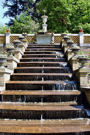 Potsdam, Germany - May 19, 2013: Fountain with sculptures of flowers in a park Sanssouci