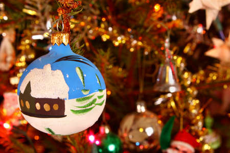 Bauble ornament hanging on the Christmas tree photo