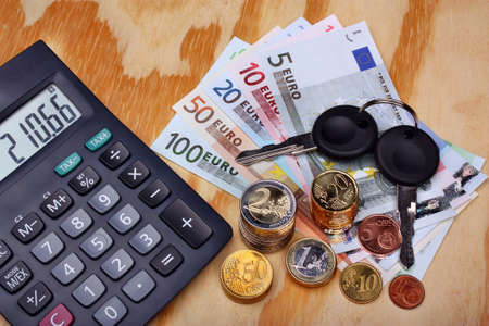 Car keys and money euro on the table