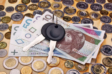 Documents car keys and money coin on the table Foto de archivo