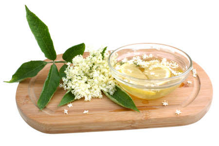 Health juicy  from elderberry flowers on a white  photo