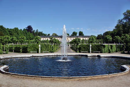 frederick street: Potsdam, Germany - May 19, 2013:  The fountain in the background of the palace Bildergalerie. Sanssouci is the most famous palace of Frederick the Great, King of Prussia Editorial