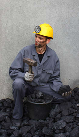 the miner: Look miner while working at breaking coal
