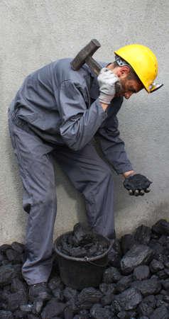 smashing: Miner hammer smashing a stone coal Stock Photo