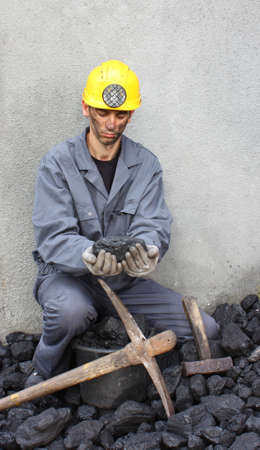 coal miner: A look at the stone coal miner who holds in his hands